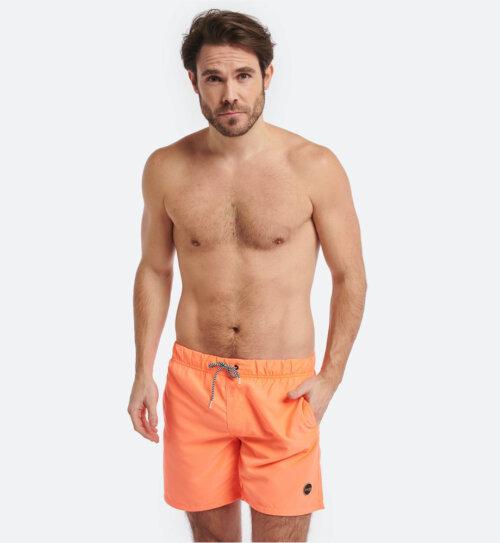 Man in fel oranje Shiwi zwembroek